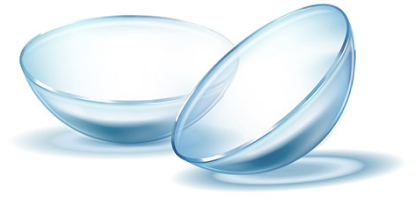 two contact lenses lying down on a transparent surface